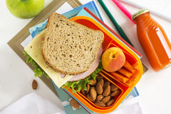 School lunch box with sandwich, fruits and nuts Royalty Free Stock Image