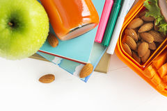 School lunch box with sandwich, fruits and nuts Stock Photos