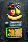 School lunch box with sandwich, vegetables, water and fruits Royalty Free Stock Image