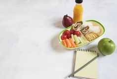 School lunch box with sandwich, vegetables, water, fruits Healthy eating habits concept - background layout with free text space. stock photography