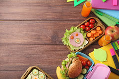 School lunch. In boxes on brown wooden table Royalty Free Stock Photos