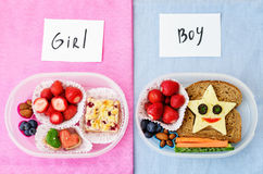 School lunch boxes for girl and boy with food in the form of fun Royalty Free Stock Images