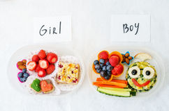 School lunch boxes for girl and boy with food in the form of fun Stock Photo