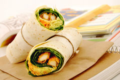 School lunch: chicken wrap sandwich with lunch bag on school desk Stock Images
