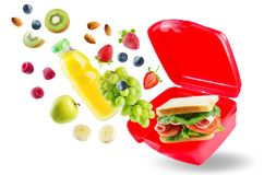 School lunch with flying sandwich, fresh fruits and juice Royalty Free Stock Photography