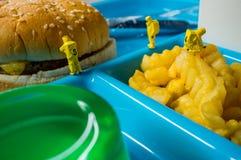 School Lunch Hazmat Health Inspection. Miniature hazmat team inspecting the nutritional value of unhealthy fast food school lunch stock photos