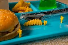 School Lunch Hazmat Health Inspection. Miniature hazmat team inspecting the nutritional value of unhealthy fast food school lunch royalty free stock photos