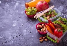 School lunch. Salad, sandwiches, fruits and nuts. School lunch. Healthy salad, sandwiches, fruits, vegetable and nuts Selective focus Stock Image