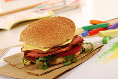 School lunch: pastrami roll sandwich on classroom desk Stock Images