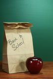School Lunch Sack Sitting on Teacher Desk Royalty Free Stock Image