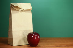 School Lunch Sack Sitting on Teacher Desk Royalty Free Stock Images