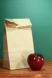 School Lunch Sack Sitting on Teacher Desk Stock Photo