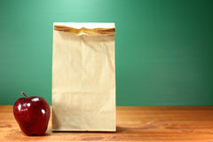 School Lunch Sack Sitting on Teacher Desk Stock Photos