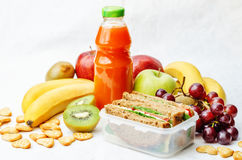 School lunch with a sandwich, fresh fruits, crackers and juice Royalty Free Stock Images