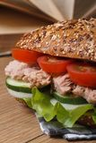 School lunch: a sandwich with tuna macro on background of books Stock Image