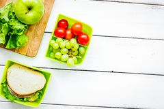 School lunch set with apple and vegetables in lunchbox backgroun Stock Photo