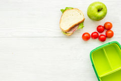 School lunch set with apple and vegetables in lunchbox background top view mock up Stock Photos