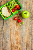 School lunch set with apple and vegetables in lunchbox background top view mock up Royalty Free Stock Images