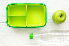School lunch set with bottle of water and lunchbox background top view mock up Royalty Free Stock Photos