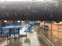 School. Lunch tables at school  in the rain Stock Photography