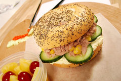 School lunch: tuna bagel sandwich on classroom desk Stock Photo