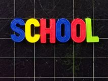 School magnetic letters on blackboard chalkboard stock images
