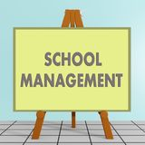 SCHOOL MANAGEMENT concept. 3D illustration of SCHOOL MANAGEMENT title on a tripod display board, along with a brown cube Royalty Free Stock Images