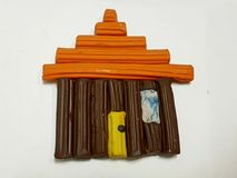 Simple design of a wooden house with plasticine. School material, background and texture, creative design Royalty Free Stock Image