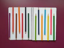 School material in composition on purple background stock photos