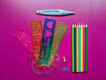 School material in composition on purple background royalty free stock photos
