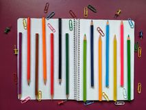 School material in composition on purple background stock images