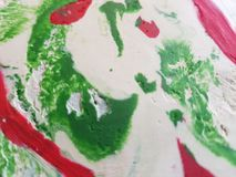 Abstract with plasticine mix in the colours white, green and red, background texture. School material for moulding, backdrop for advertisements with mixing Stock Photos