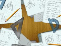 School math calculations on a wooden desk Royalty Free Stock Images