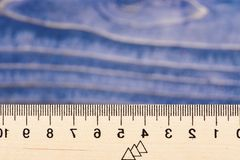 School, mathematics, geometry concept. Wooden ruler close up on blue background. Simple ruler with indicators in form of royalty free stock image