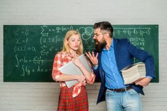 School mathematics lessons. University seminar. Tutor. Tutoring. Concentrated students following explanations of teacher stock image