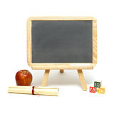 School Message Board. A blank chalkboard with other school items for displaying your message stock image