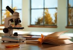 School microscope in classroom Royalty Free Stock Photo