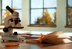 School microscope in classroom Royalty Free Stock Photo