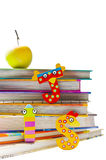 School is so much fun. Stack of books with funny letters and a healthy snack Royalty Free Stock Photography