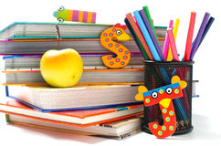 School is so much fun. Stack of books with funny letters and a healthy snack Stock Images