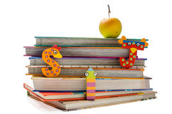 School is so much fun. Stack of books with funny letters and a healthy snack Royalty Free Stock Images