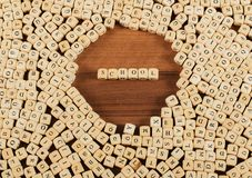 School name in letters on cube dices on table stock photography