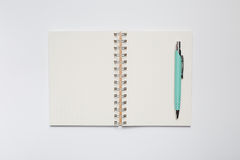 School notebook with stylish green pen Royalty Free Stock Image