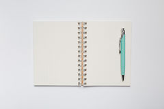 School notebook with stylish green pen Stock Image