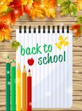 School notebook with the text on the wooden background with autumn leaves. Vector illustration. School notebook with the text on the wooden background with Royalty Free Stock Photos