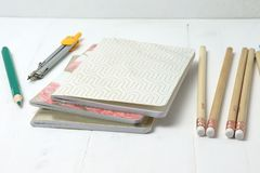 School notebooks and pencils stock photo