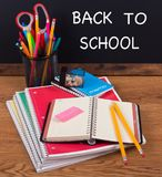 Back To School Supplies on a Wooden Desktop Royalty Free Stock Photography