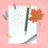 School notepad with pencil and autumn leaf Royalty Free Stock Photo