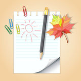 School notepad with pencil and autumn leaf Stock Photography