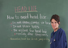 School nurse and head lice Stock Image